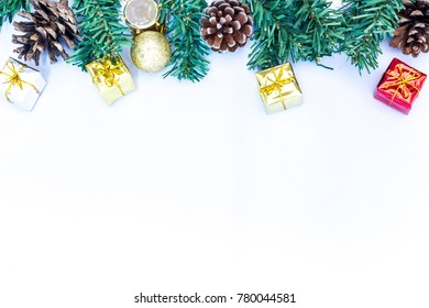 Christmas background with decorations and gift boxes on white background