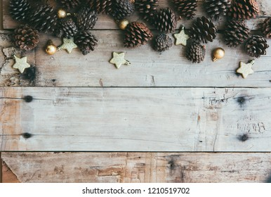 Christmas background with decorations and golden stars on the wooden table.