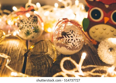 Christmas background with christmas decorations and christmas lights on wooden table
