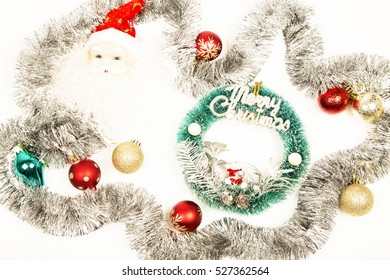 Christmas background ,decorations, red baubles ,glitter ,white background  ,santa clause ,yellow heart ,tromped ,star .silver ,green ,merry christmas text
