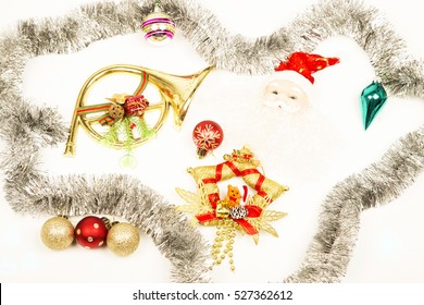 Christmas background ,decorations, red baubles ,glitter ,white background  ,santa clause ,yellow heart ,tromped ,star .silver ,