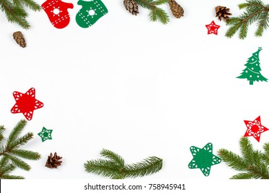 Christmas background with decorations, spruce branches and pine cones. Christmas pattern on white background. View from above, top, horizontal