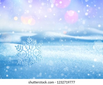 Christmas background with  decorative snowflake on brilliant snow. Winter background for cards.