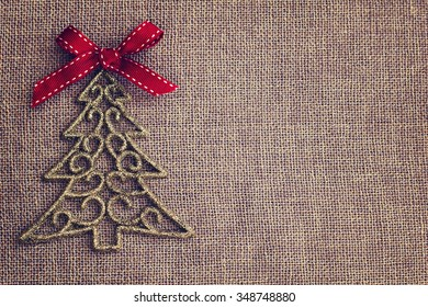 Christmas background with decorative tree and red bow