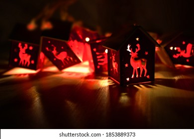 Christmas background. deer garland with warm lights and copy space. Background with lanterns lights. Christmas garland. New Year. Glowing lights for Christmas holiday cards Warm light garlands