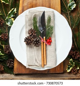 Christmas background with an empty plate. decorations for the New Year's table. space for writing text