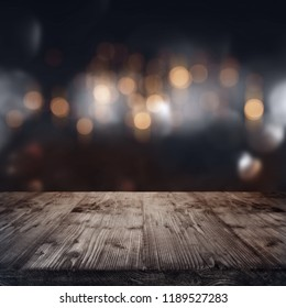 Christmas background with festive bokeh and rustic wooden table