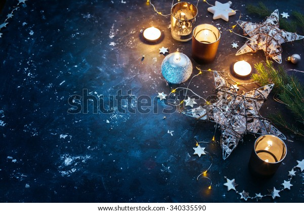 Christmas background with festive decoration, stars and candles. Christmas background with copyspace