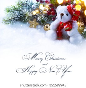 Christmas background with a festive ornament and fir tree in snow