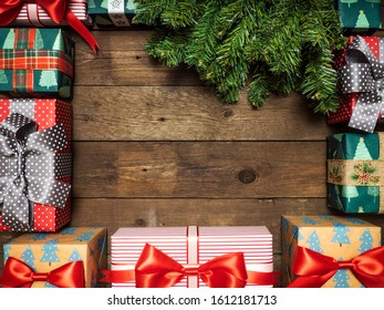 Christmas background. Fir branches with cones on the wooden background. Top view. Holiday concept