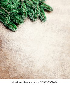 Christmas Background  with fir tree branches on bright  wooden background. Christmas vintage wallpaper. Flat lay, Top view. Copy space