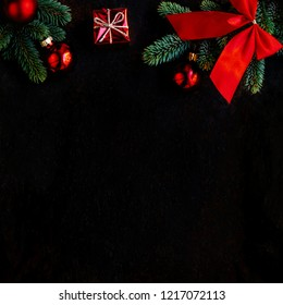 Christmas background with fir tree and decoration on  black board. Flat lay. Christmas Greeting Card. Copyspace.