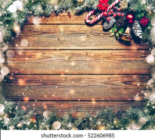 Christmas background with fir tree and decoration on dark wooden board