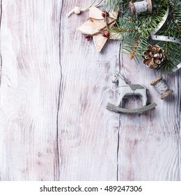 Christmas background with fir tree and decorations. Old wooden board. Top view with copy space for text.