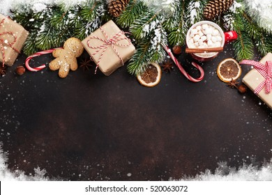 Christmas background with fir tree, hot chocolate and marshmallow. Top view with copy space