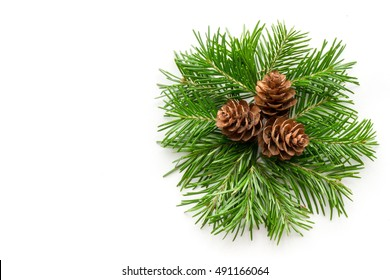 Christmas background. A Fir twigs and cones wreath. Top view.