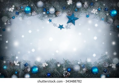 Christmas background with a frame of fir branches decorated