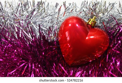 Christmas background with garland and red heart