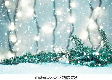Christmas background with garland, Christmas tree branches, snow and decorations on wooden table