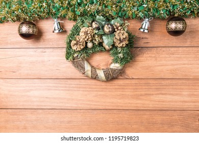 Christmas background with garlands and Christmas decorations on wooden table.