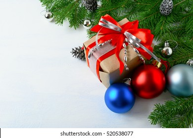 Christmas background with gift box, blue and red ornaments. New year greeting card, copy space.