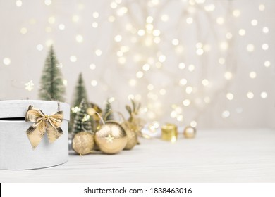 Christmas background , gift box with a Golden bow on the background of Christmas bokeh