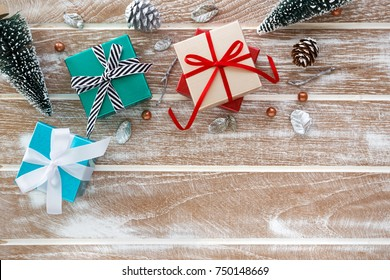 Christmas background with gift box and christmas tree  on wooden table flat lay with copy space