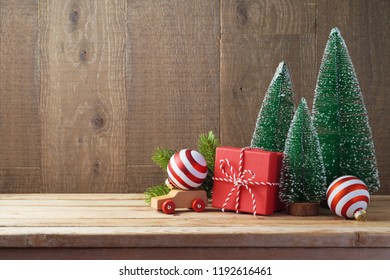 Christmas background with gift boxes and ornament on wooden table