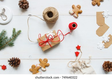 Christmas background. Christmas gift with christmas decorations on the wooden white table. Top view