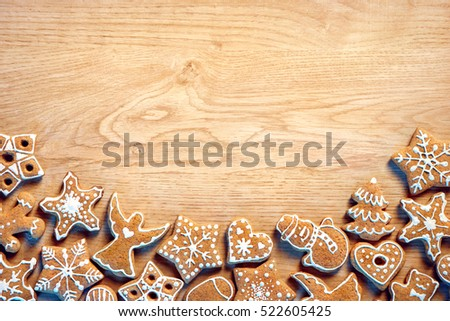 a9ea068add01f Christmas background with Gingerbread cookies on wooden table. Copy space  for your text. Top