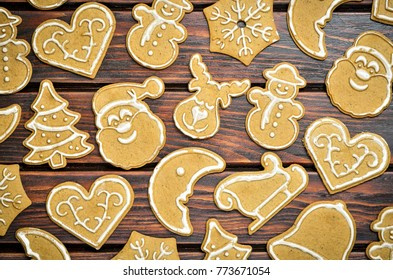 Christmas background with gingerbread. Sweet gingerbreads on a wooden table.