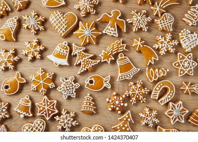 Christmas background with gingerbreads on wooden table, homemade biscuits