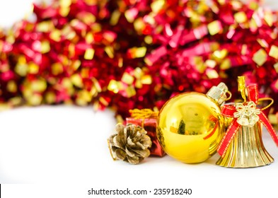 Christmas background with a gold ornament