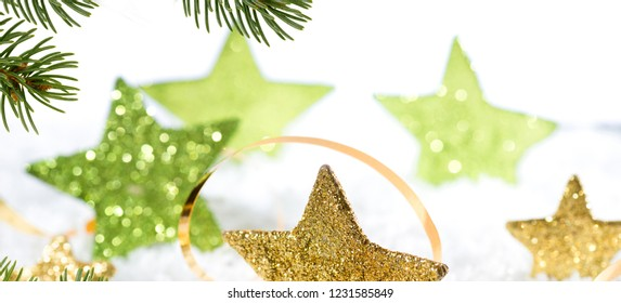 Christmas background with gold stars and christmas twig