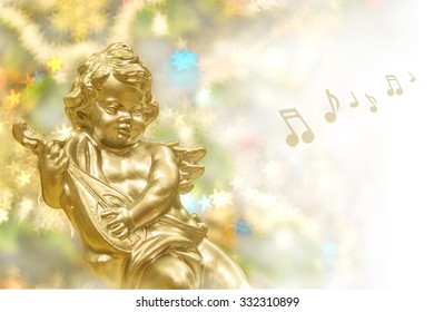 Christmas background, golden angel with music instrument