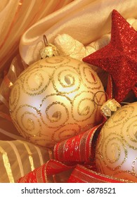 Christmas background with golden ball, stars and red ribbons