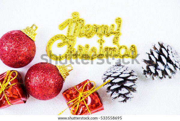 Christmas background with a golden and red ornament,gift box,pine cones and merry christmas text