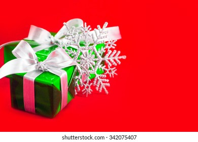Christmas background with green box and silver ribbon