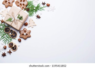 Christmas background for greeting cards, banners and party posters. New Year's eve celebration, sale, presents concept. Beautiful gift box with festive decorations, flat lay with copyspace