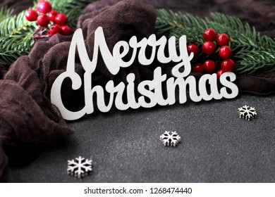 Christmas background for greeting cards or Happy New Year on a dark background with snowflakes and ornaments