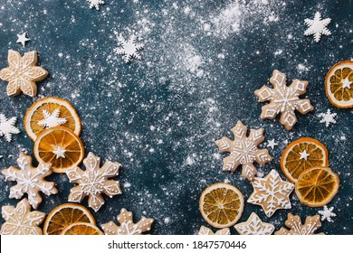 Christmas background with homemade gingerbread cookies on blue table, copy space. Festive food, New Year celebration traditions