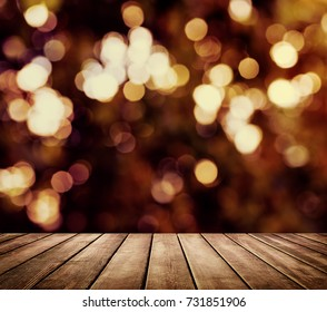 Christmas background with light spots and bokeh with empty table for your montage