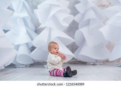 christmas background little girl drinking milk with white christmas trees background