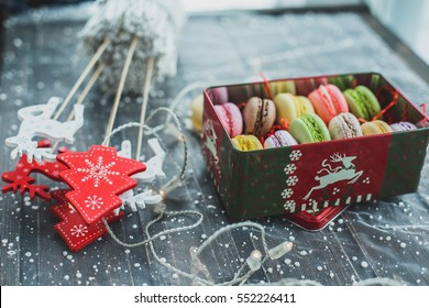 Christmas background with macaroons garlands and snow
