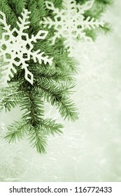 Christmas background made of spruce branch and snowflakes