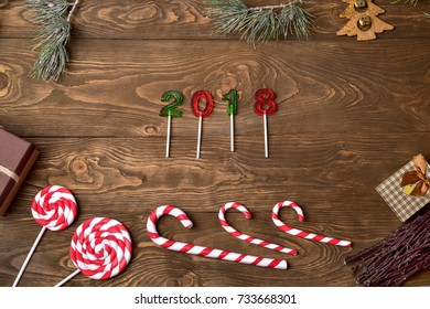 Christmas background.  Merry Christmas. New year 2018 on a rustic wooden background.  Caramel candies.