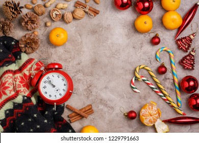 Christmas background. New Year's holiday with tangerines and sweets. View from above. Free space for your text. Flat lay.