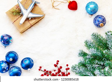 Christmas background on the theme of travel. The plane symbolizes the gift of the journey. Selective focus. Holiday