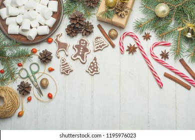 Christmas background on white wooden boards with biscuits and gifts,Christmas cookies