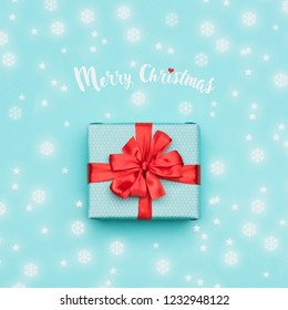 Christmas background. Pastel blue festive winter holidays backdrop. Beautifully wrapped christmas present. Xmas card.